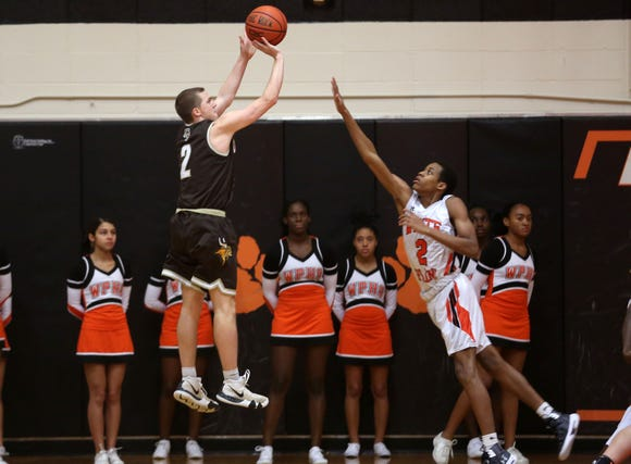 Clarkstown South's Tony Hasting's (2) puts up a shot in front of White Plains' Eisaiah Murphy (2) during boys basketball action at White Plains High School Dec. 11, 2018. White Plains won the game 64-56.