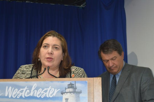 County Legislator Catherine Borgia, D-Ossining, speaks about the county budget, at County Executive George Latimer's press conference.