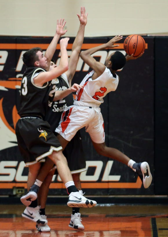 White Plains' Eisaiah Murphy (2) is fouled as he goes up for a shot by Clarkstown South's Brad Timmerberg (23) during boys basketball action at White Plains High School Dec. 11, 2018. White Plains won the game 64-56.
