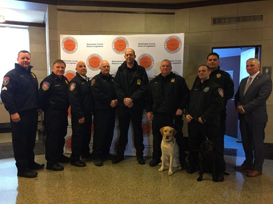 Members of the Westchester County police Hazardous Device Unit pose outside of the county Board of Legislators' chambers on Dec. 10, 2018. They're standing with Public Safety Commissioner Thomas Gleason after being recognized for handling package bombs sent to George Soros and Hillary Clinton.