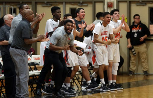 The White Plains bench cheers after a basket against Clarkstown South during boys basketball action at White Plains High School Dec. 11, 2018. White Plains won the game 64-56.