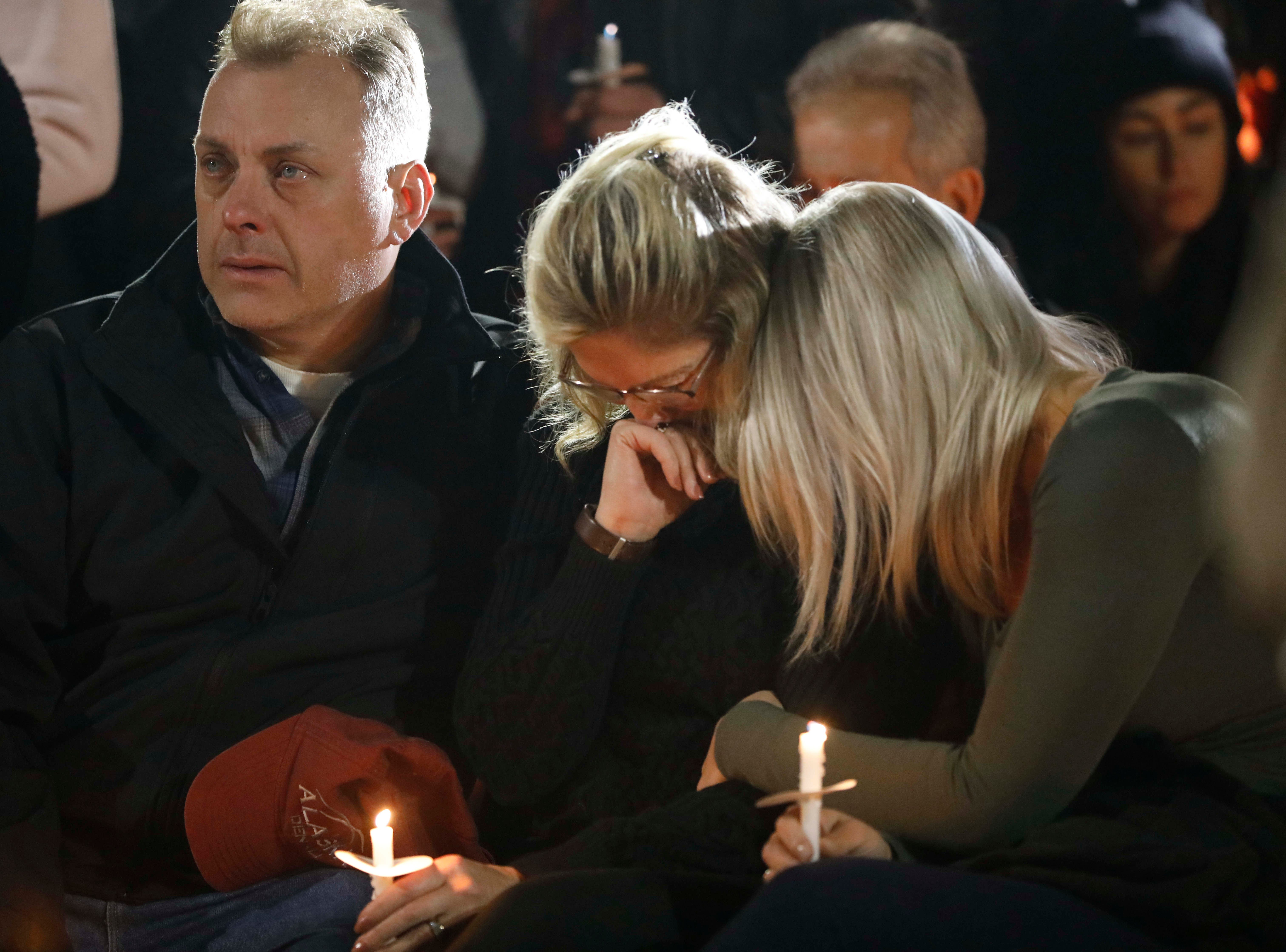 Family members console one another at the The Mohawk Valley Gateway Overlook Bridge in the City of Amsterdam on Oct. 8, 2018, during a candlelight vigil for the 20 people who were killed in a limousine accident in Schoharie on Saturday. on Oct. 8, 2018.