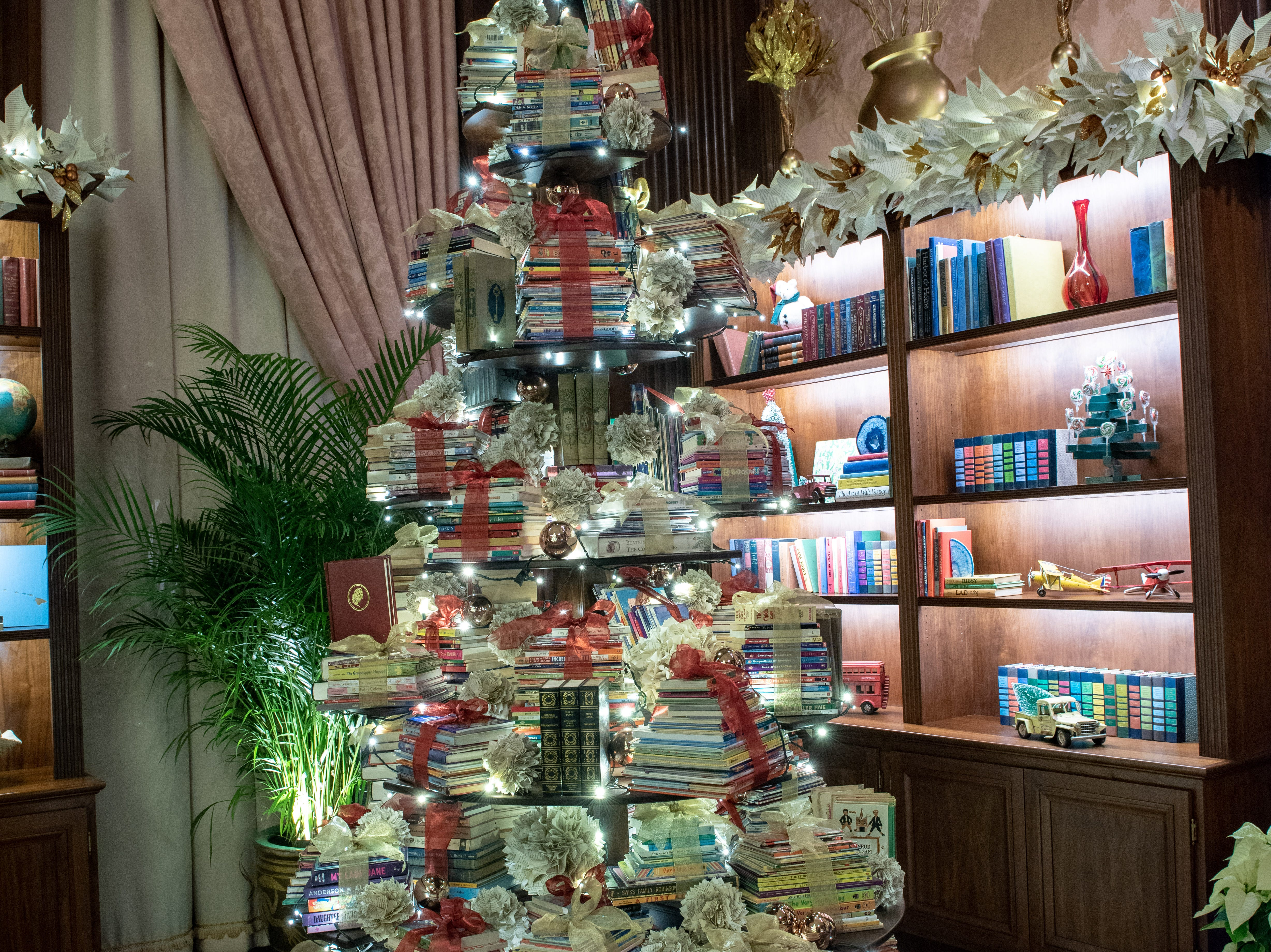 This tree of stacked children's books will be donated after A Longwood Christmas ends Jan. 6.