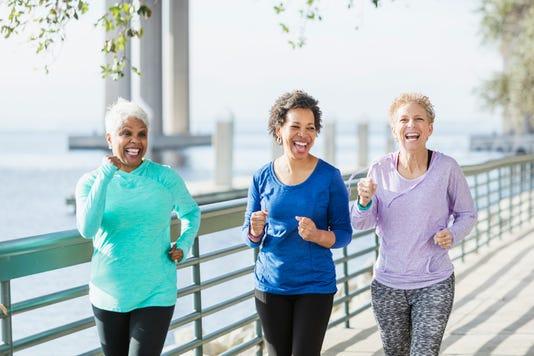 Three Mature And Senior Women Running On Waterfront