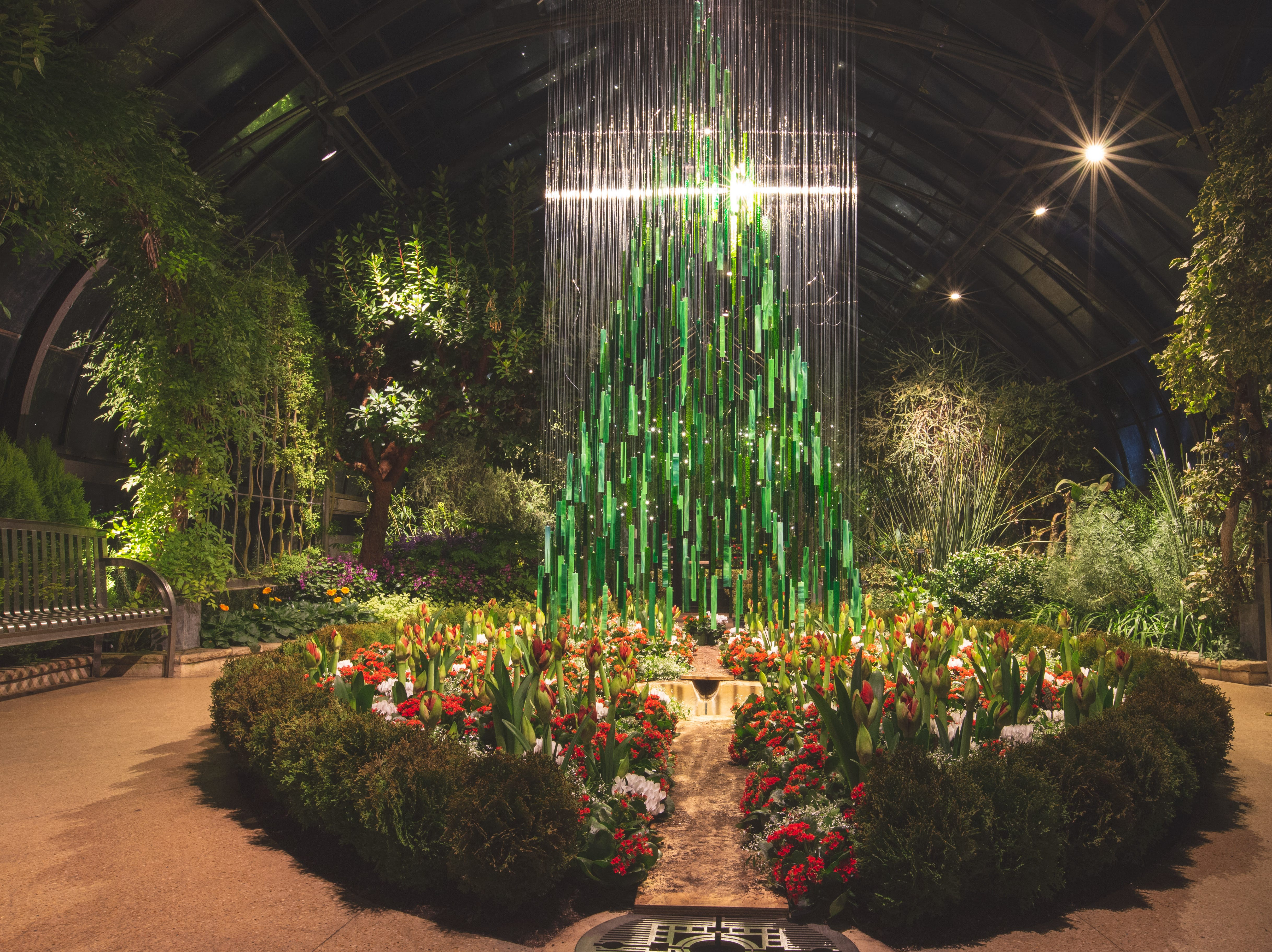 The tree in Longwood's Mediterranean garden is fashioned out of 600 rectangular pieces of glass, stained in various shades of green.