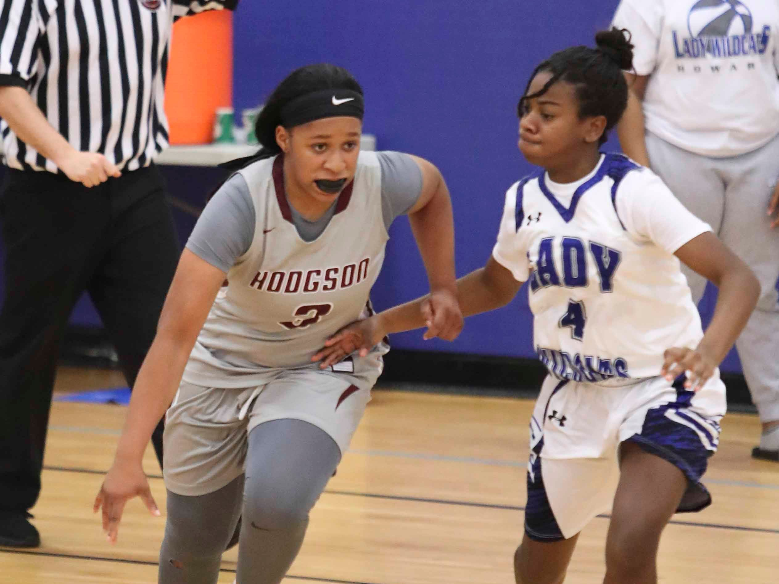 Hodgson's Kayla Braxton-Young (left) moves against Howard's Makayla Ellerbe in Hodgson's 50-47 win at Howard Tuesday. The Silver Eagles pulled away in the final minutes of a tied game and survived a final Howard possession to win.