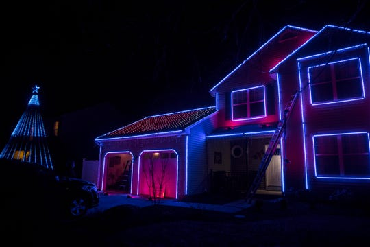 Christmas lights shine at the Mussers' home at 6 Hudson Court, near Bear.