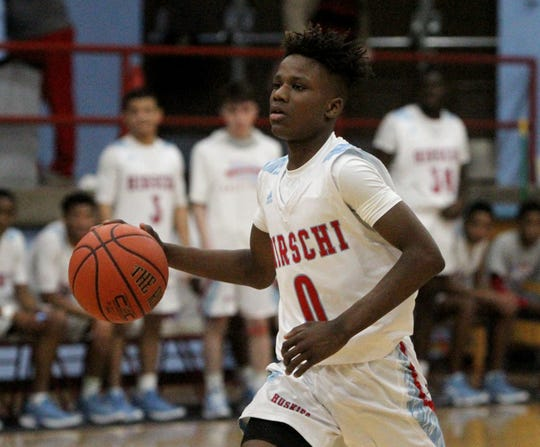 Hirschi's Ernest Young dribbles in the game against Rider Tuesday, Dec. 11, 2018, at Hirschi. The Raiders defeated the Huskies 55-37.