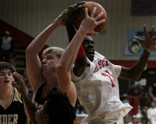 Rider's Ben Moffat, left, and Hirschi's Kiove Nelson go for the rebound Tuesday, Dec. 11, 2018, at Hirschi. The Raiders defeated the Huskies 55-37.