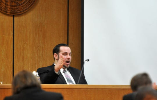 Justin Love testifies during his trial in the 30th District Courtroom.