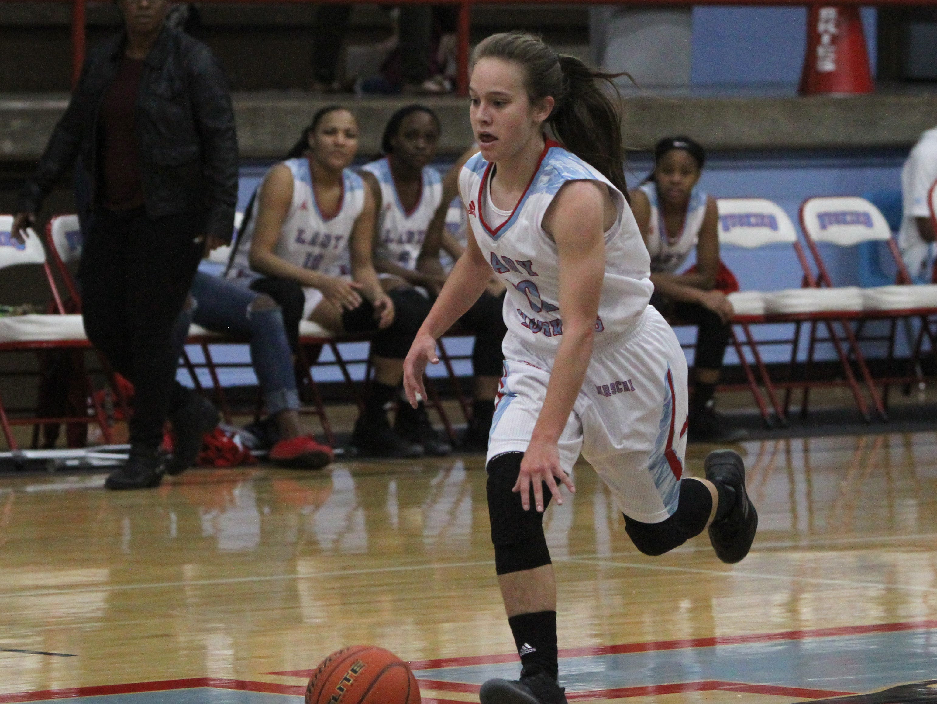 Hirschi's Michinsi Montoya dribbles in the game against Rider Tuesday, Dec. 11, 2018, at Hirschi. The Lady Huskies defeated the Lady Raiders 51-35.