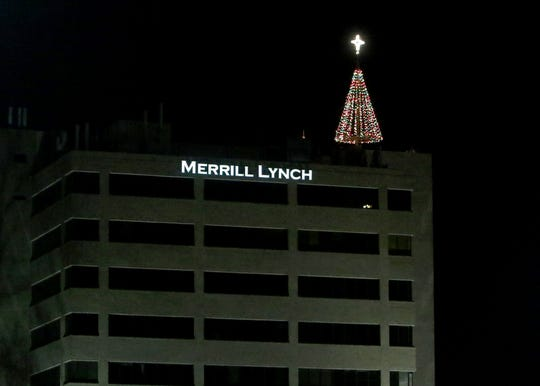 In this file photo from 2017, Hospice of Wichita Falls lit the tree atop the Chase Bank building after reaching their Tree of Lights fundraising goal. This year's goal is $250,000, and if Hospice reaches their goal by 5 p.m. Friday, they will light up the star on the tree at 6 p.m.