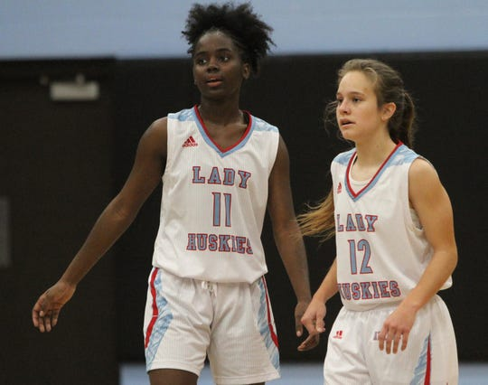Hirschi senior Patience Murphy (left) and junior Michinsi Montoya join each other on the Red River 22 team.