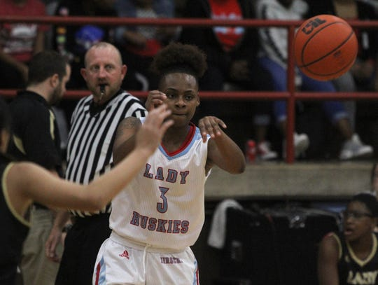 Hirschi's Eternity Hull passes in the game against Rider Tuesday, Dec. 11, 2018, at Hirschi. The Lady Huskies defeated the Lady Raiders 51-35.