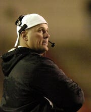 Former Rider head coach Scott Ponder looks to the scoreboard after the Frenship Tigers scored the go-ahead touchdown in a 20-17 Region I-4A finals win over Rider at  Jones Stadium in Lubbock. The Raiders  had started that season 0-3, including another tough loss (14-12) to Frenship, but grew up fast and stormed through the first three rounds of the playoffs.