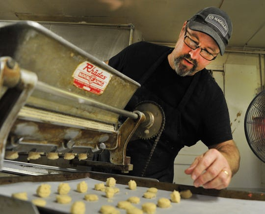 Margie's Sweet Shop, Bakery Manager, Mathew Gerstner prepares a batch of vanilla Wafers to be baked Wednesday afternoon in their Bakery located on Call Field Rd.