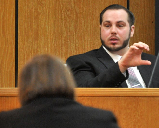 Justin Love testifies in his own defense during his trial in 30th District Court as shown in this Dec. 12, 2018, file photo. Love was convicted of murdering Domanic Thrasher but won a new trial on appeal.