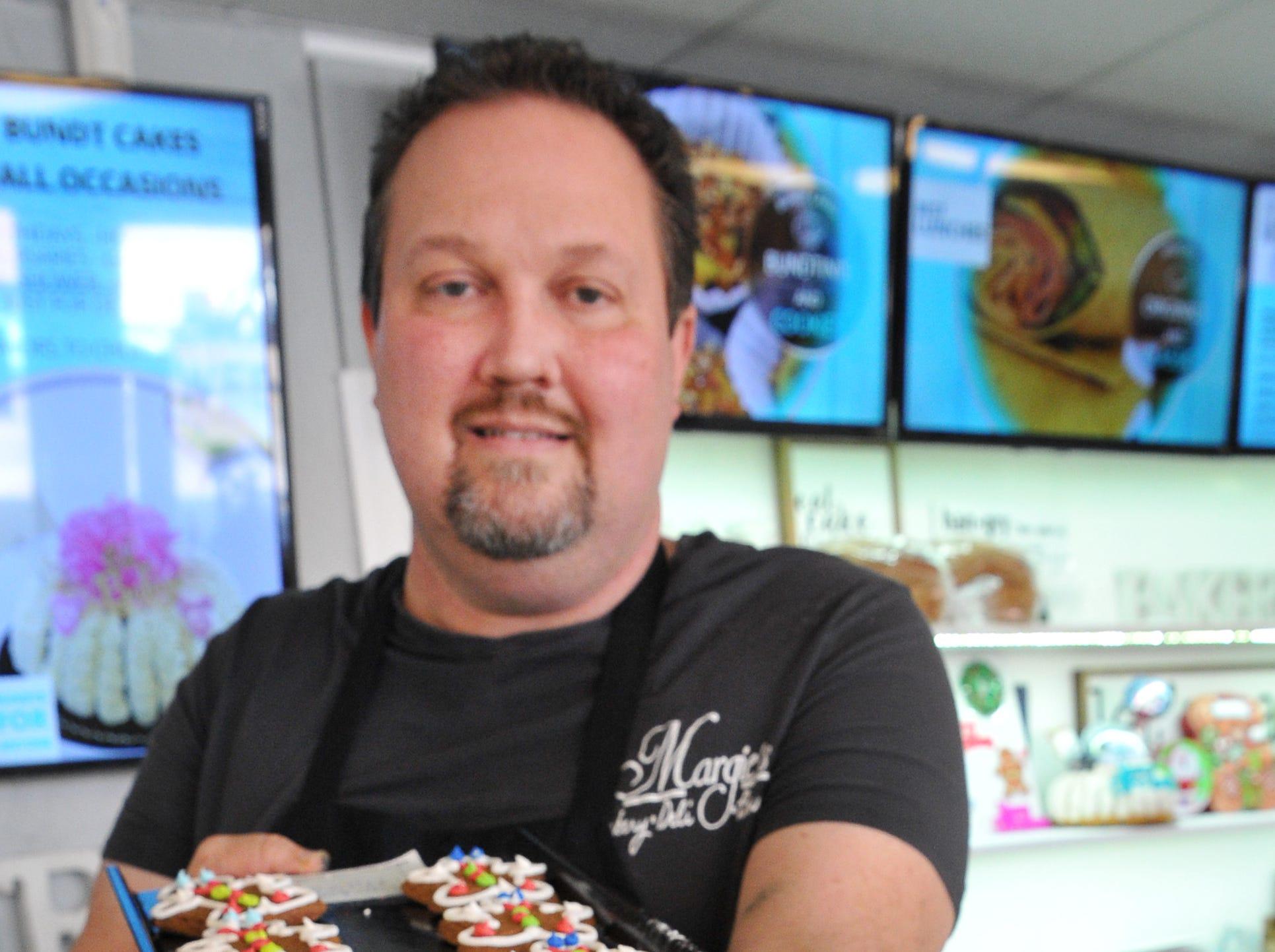 Margie's Sweet Shop, Owner, Michael Gerstner displays one of his bakery's most popular treats, Gingerbread Boys.
