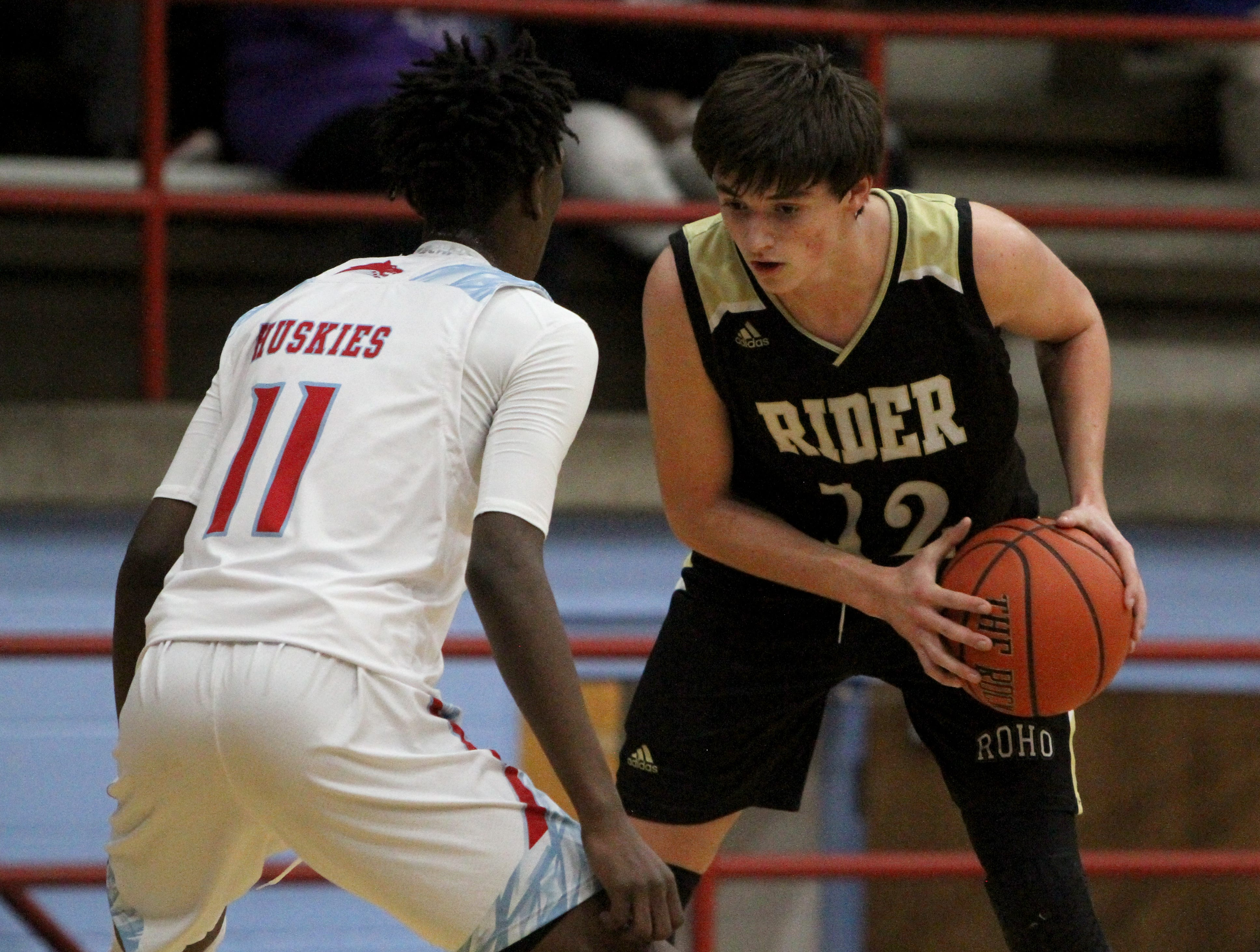 Rider's Ty Caswell is guarded by Hirschi's Qua Easter Tuesday, Dec. 11, 2018, at Hirschi. The Raiders defeated the Huskies 55-37.