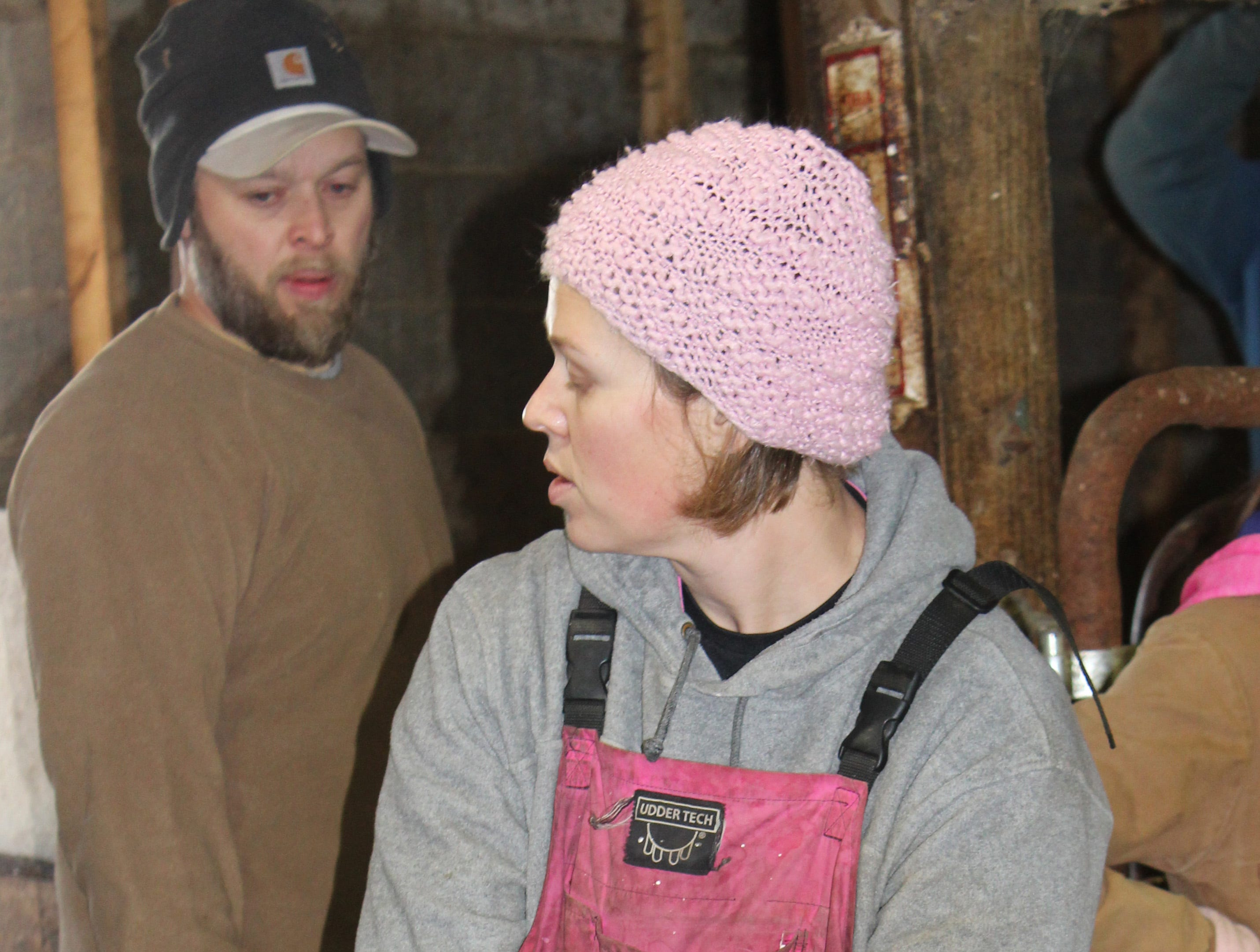Jennifer Boelk holds on to a Southdown ewe awaiting her turn to be sheared.