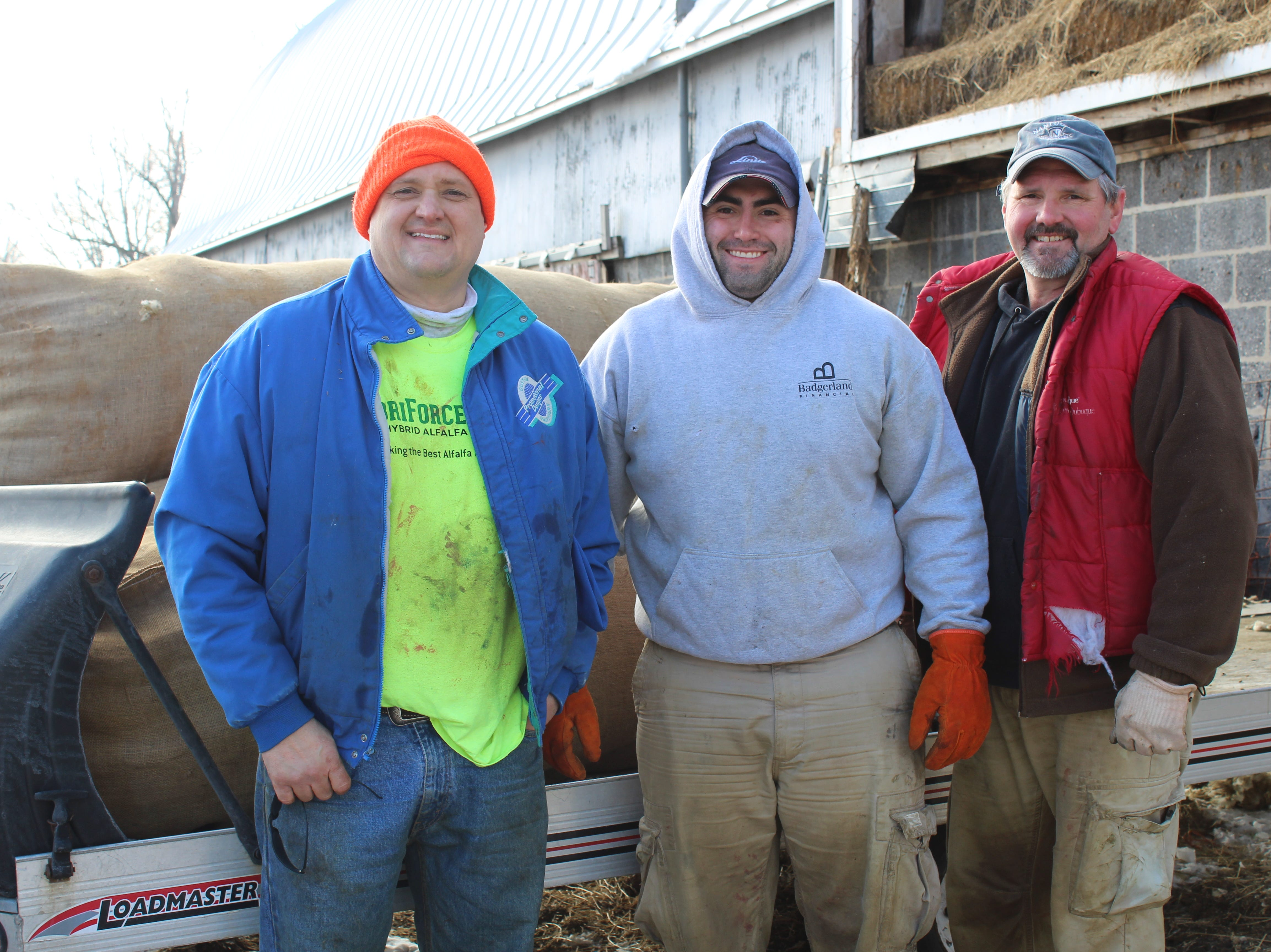 Jerry Held (left) is joined by his brother, Jay Held (right) and Jay's son, Jacob  Held, at Cottonwood Creek Farms after a morning of shearing sheep on Dec. 8.