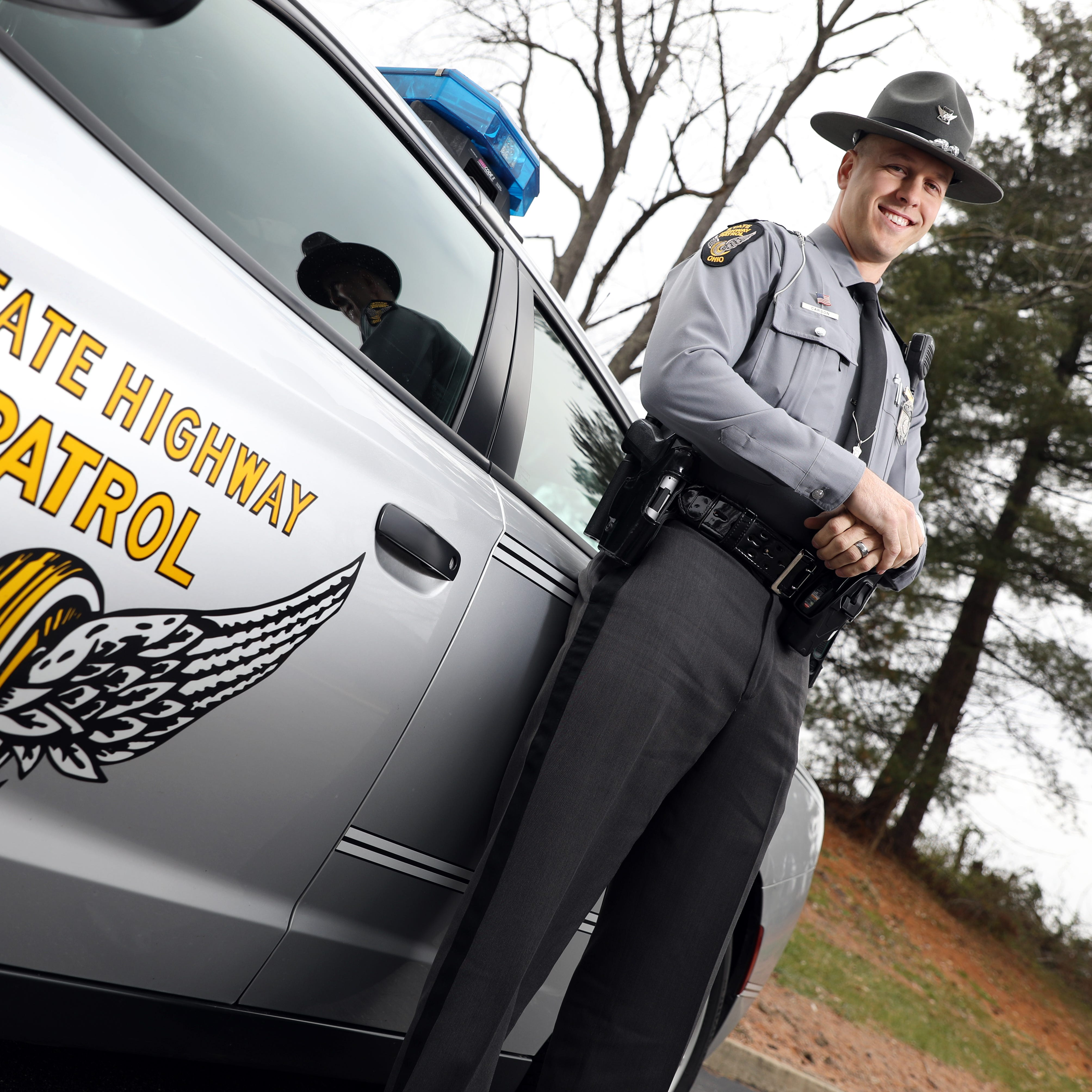 Local trooper honored by two districts for his work
