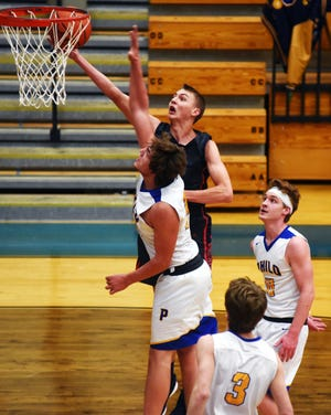 Morgan's Tyler Janes goes up for a layup over Philo's Hunter Moore during the Raiders' 56-55 win on Tuesday night at the Power Plant.