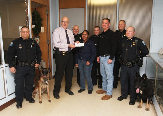 Representatives from Nestle Purina presented a donation to the Zanesville Police Department that will allow the department to add another K-9 officer to its ranks.