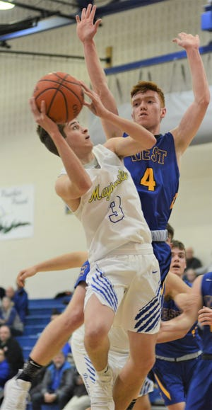 Maysville's Kaiden Hartman goes up for a shot against West Muskingum's Justin Slater in the Panthers' 68-66 win on Tuesday in MVL action.