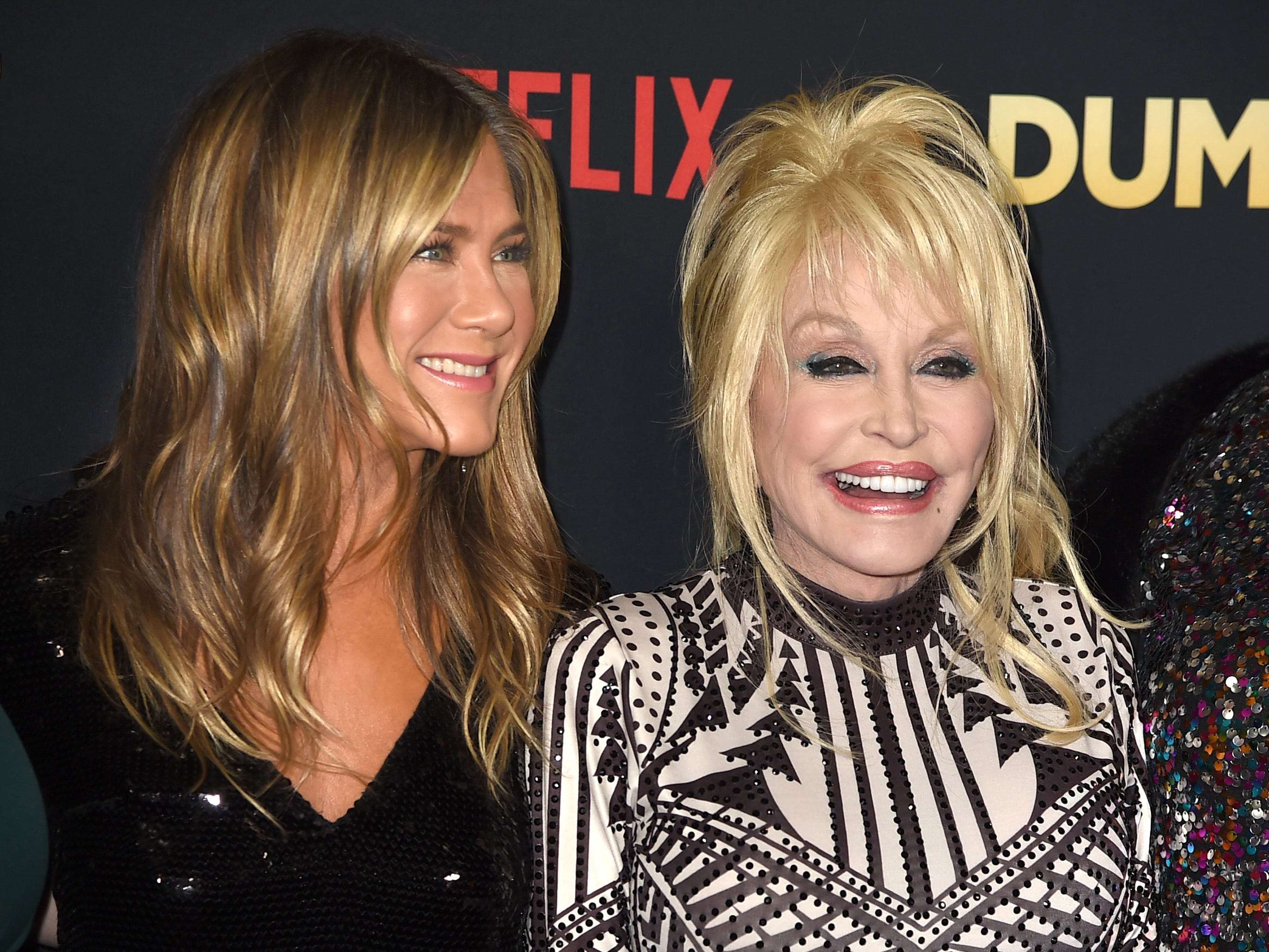 """LOS ANGELES, CA - DECEMBER 06:  Jennifer Aniston (L) and Dolly Parton arrive at the premiere of Netflix's """"Dumplin'"""" at the Chinese Theater on December 6, 2018 in Los Angeles, California.  (Photo by Kevin Winter/Getty Images) ORG XMIT: 775264138 ORIG FILE ID: 1069374270"""