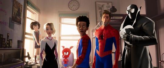 Peni (Kimiko Glenn, left), Spider-Gwen (Hailee Steinfeld), Spider-Ham (John Mulaney), Miles Morales (Shameik Moore), Peter Parker (Jake Johnson) and Spider-Man Noir (Nicolas Cage) make for a colorful crew.