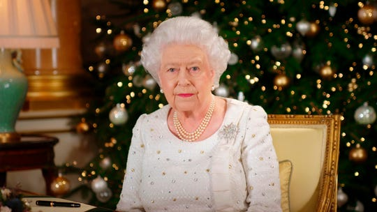 Queen Elizabeth II poses at her desk in the 1844 Room at Buckingham Palace, on Dec. 13, 2017, after recording her Christmas Day broadcast to the nation and the Commonwealth.