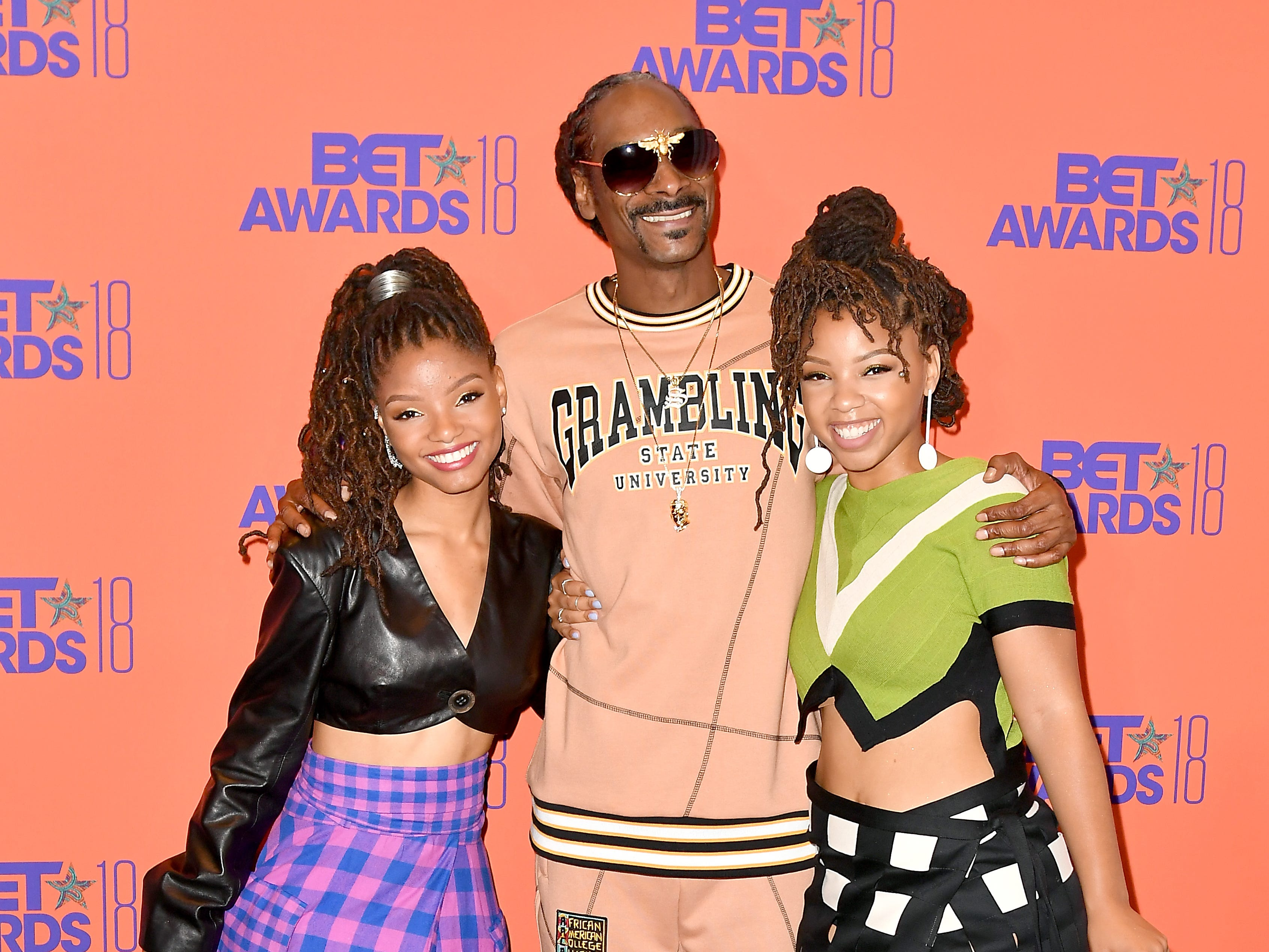 June 24:  Snoop Dogg poses with Halle Bailey and Chloe Bailey of Chloe X Halle at the 2018 BET Awards in Los Angeles.
