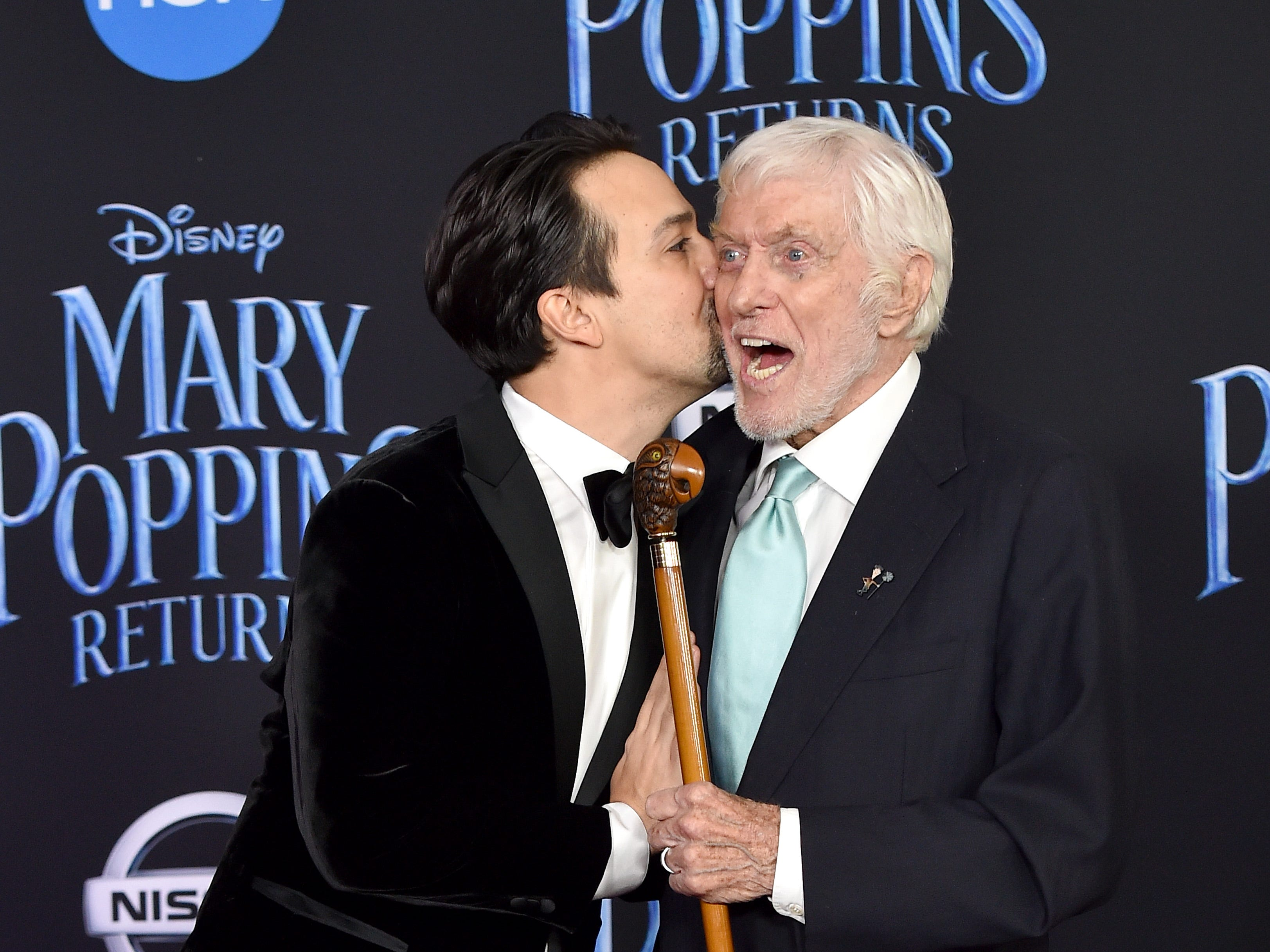 "November 29: Lin-Manuel Miranda surprises Dick Van Dyke on the red carpet for ""Mary Poppins Returns."""