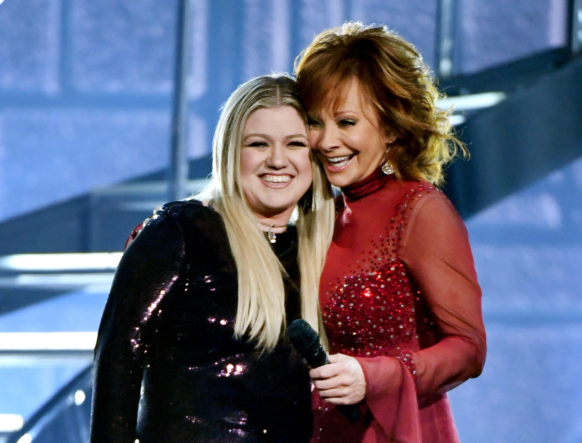April 15:  Kelly Clarkson and host Reba McEntire perform onstage during the Academy of Country Music Awards in Las Vegas.