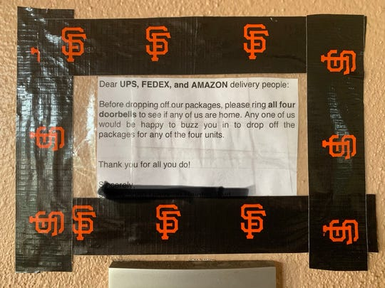 A sign posted by residents of a San Francisco condo complex asking delivery personnel to ring all the units, so packages can be taken inside so they're not stolen. Residents say that few delivery personnel actually ring the doorbells, however.