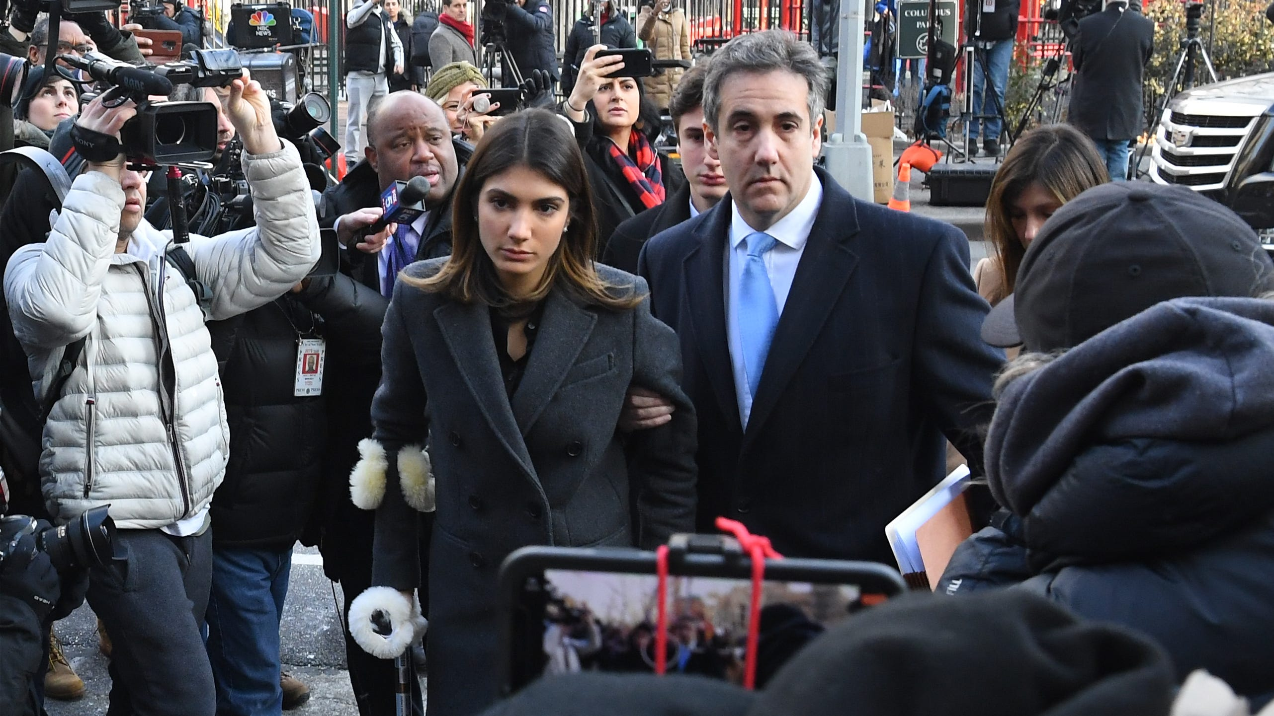 Michael Cohen, President Donald Trump's former personal lawyer, arrives with daughter Samantha Blake Cohen and wife Laura Shusterman, at right, at U.S. District Court New York on Dec. 12, 2018. He was to be sentenced for campaign-finance violations and lying to Congress.