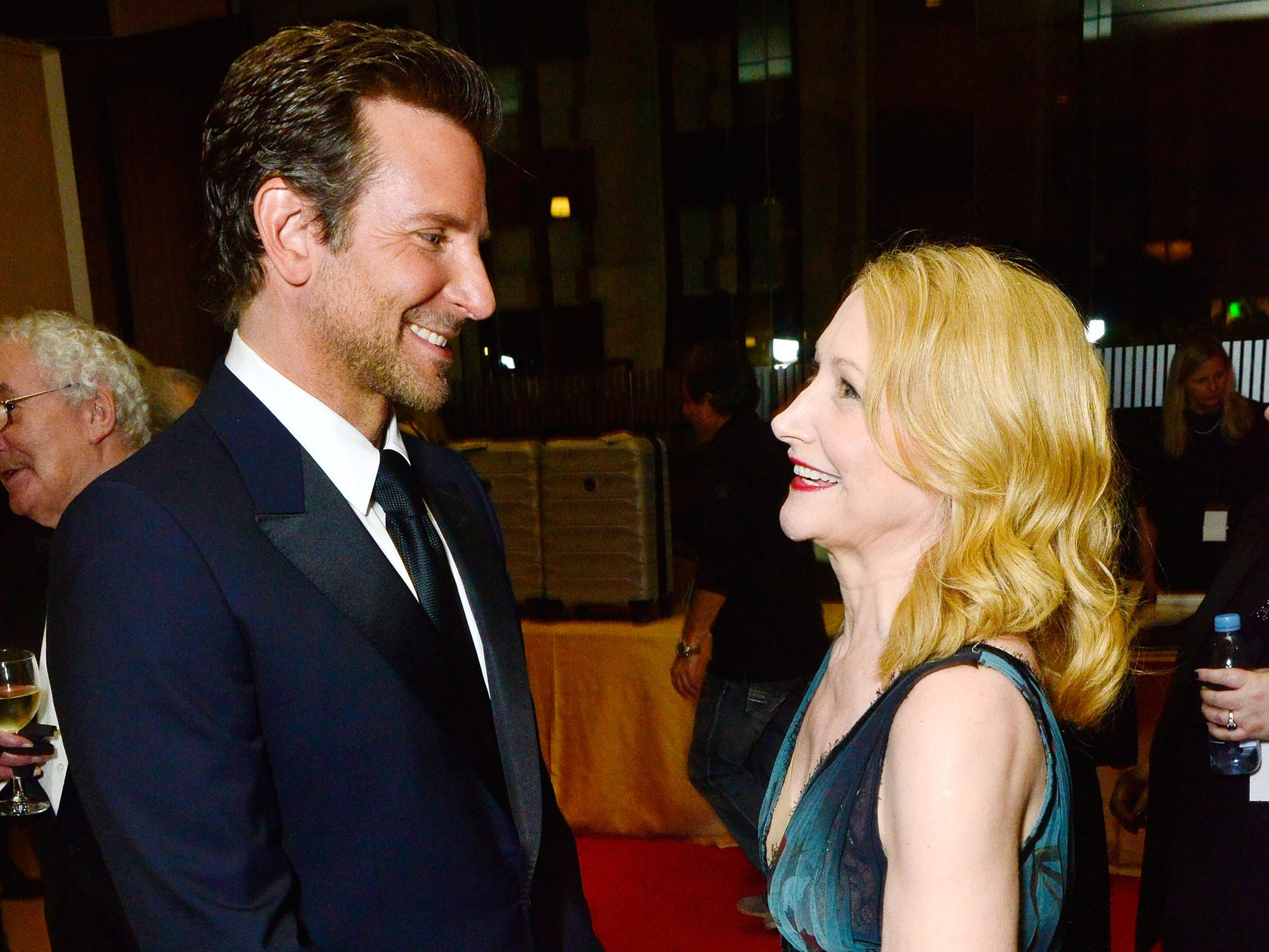 November 29:  Bradley Cooper and Patricia Clarkson chat at the American Cinematheque Awards.