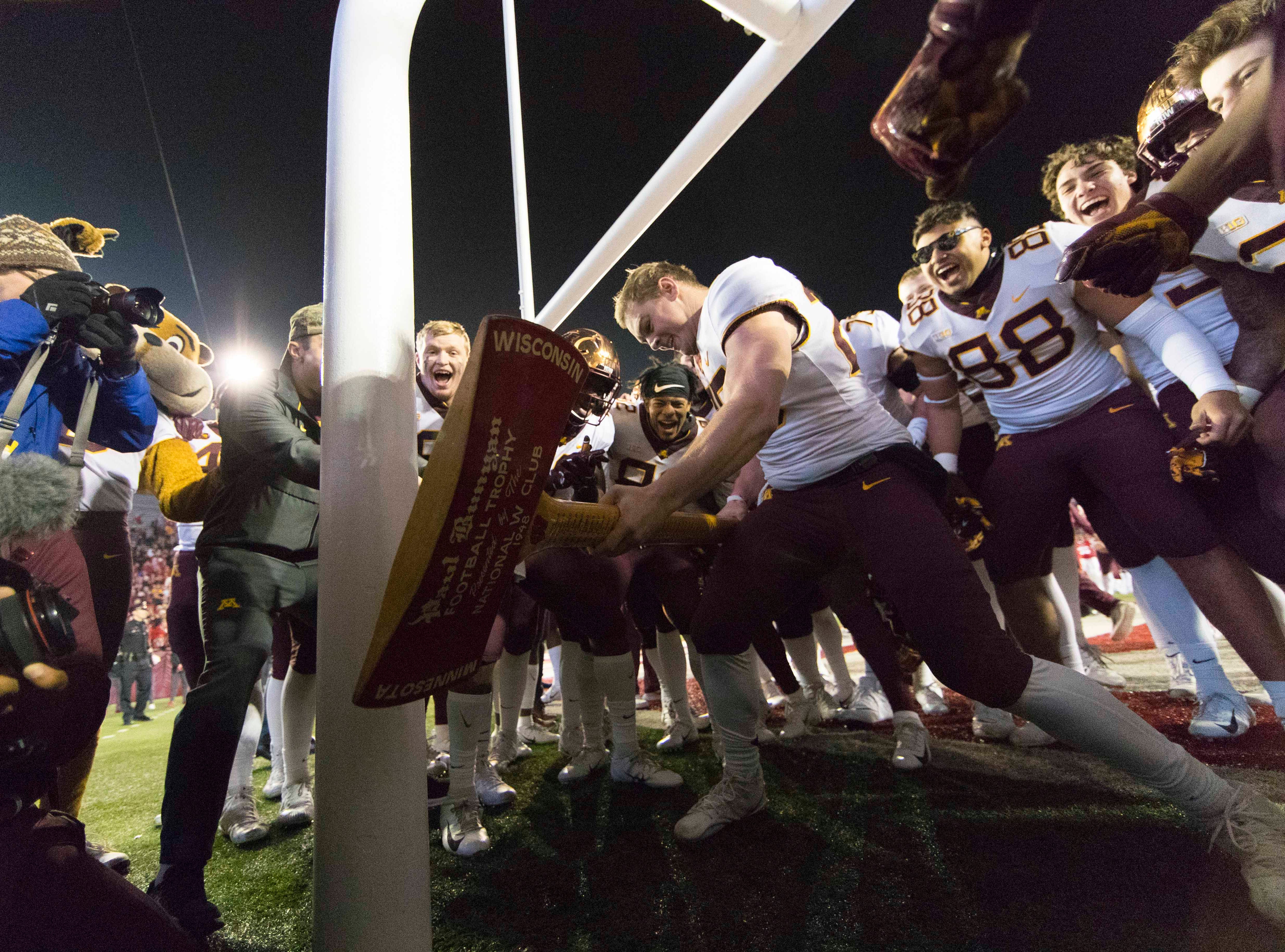 Nov. 24: The Minnesota Golden Gophers celebrate with Paul Bunyan's Axe after beating the Wisconsin Badgers at Camp Randall Stadium.