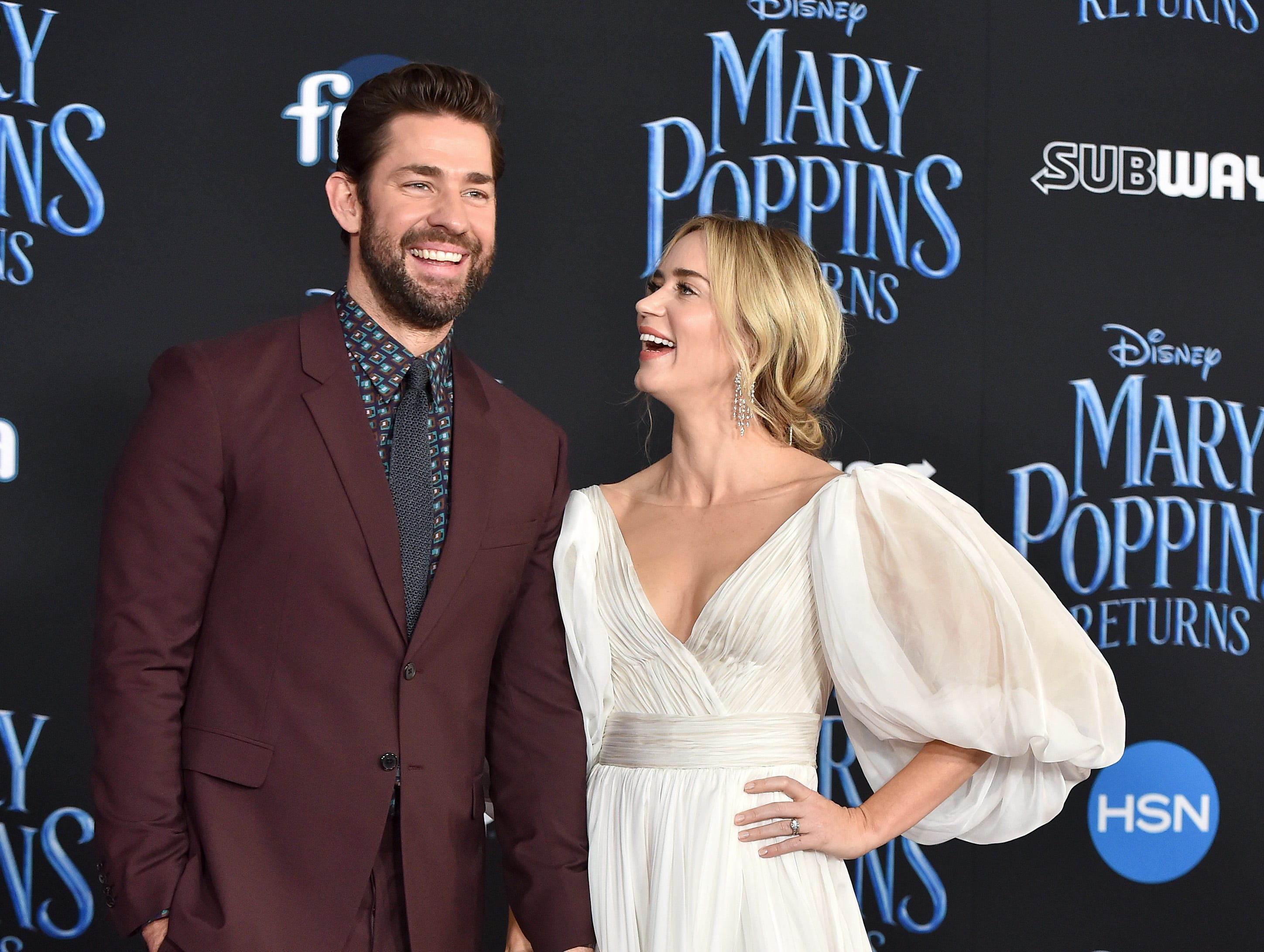 """November 29: Emily Blunt and John Krasinski pose together at the Los Angeles premiere of """"Mary Poppins Returns."""""""