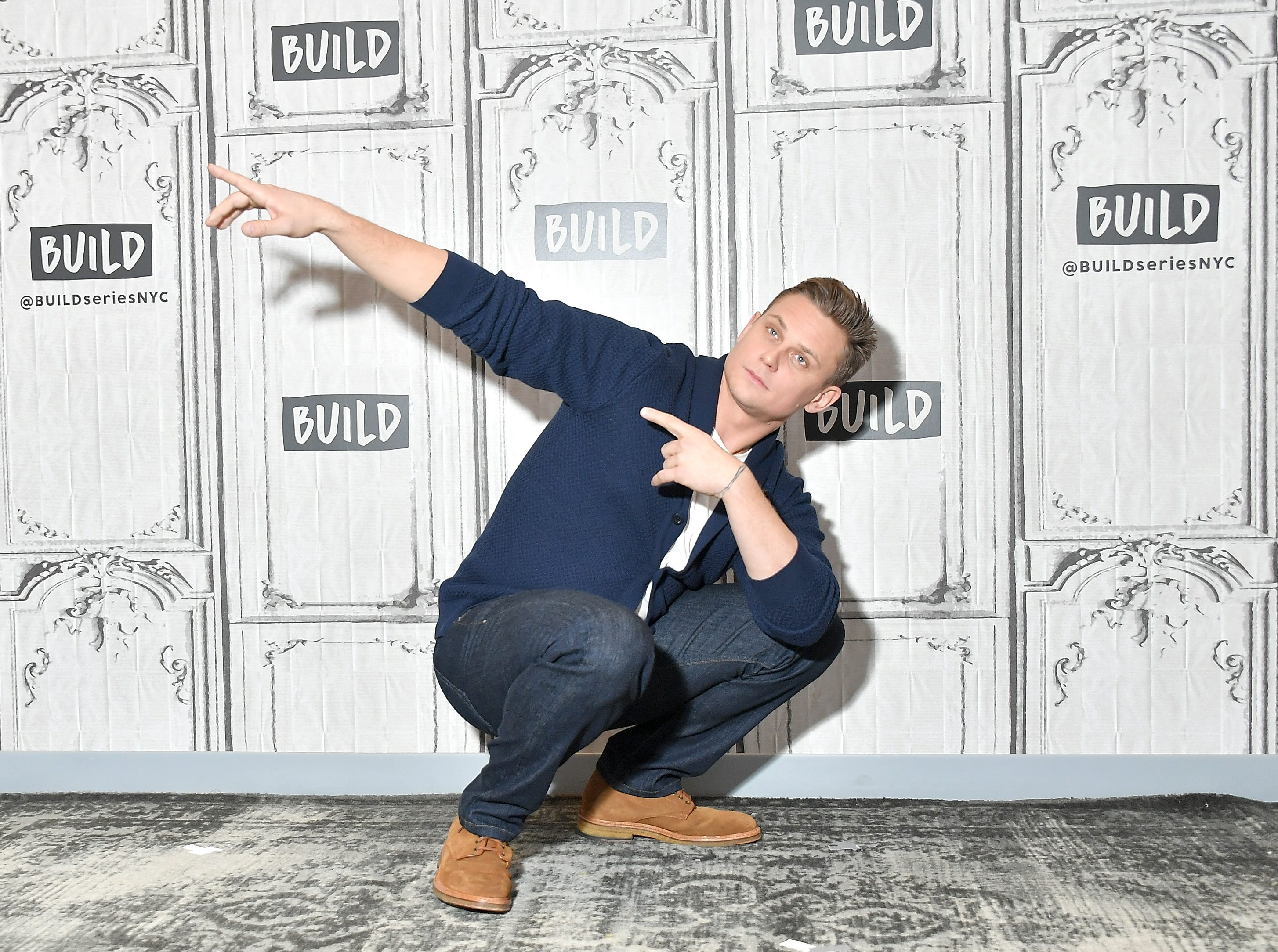 """Feb. 23:  Billy Magnussen strikes a pose before an interview about """"Game Night"""" in New York City."""