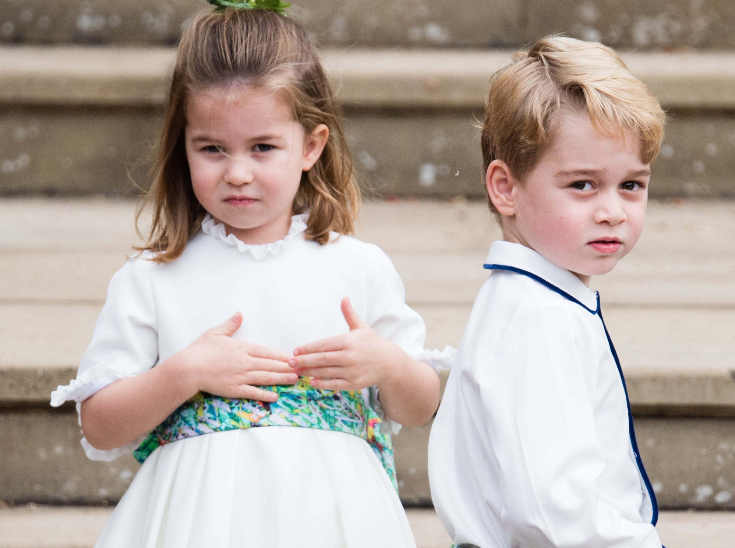 October 12: Princess Charlotte and Prince George stole the show at Princess Eugenie's wedding in Windsor, England.