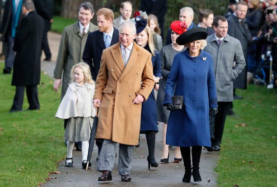A clutch of British royals, led by Prince Charles and his wife, Camilla Duchess of Cornwall, walk to attend a Christmas service in Sandringham, Dec. 25, 2016.