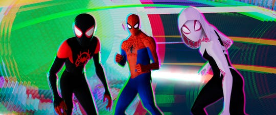 "Miles Morales (voiced by Shameik Moore, left), Peter Parker (Jake Johnson) and Spider-Gwen (Hailee Steinfeld) are here to save the day in ""Spider-Man: Into the Spider-Verse."""