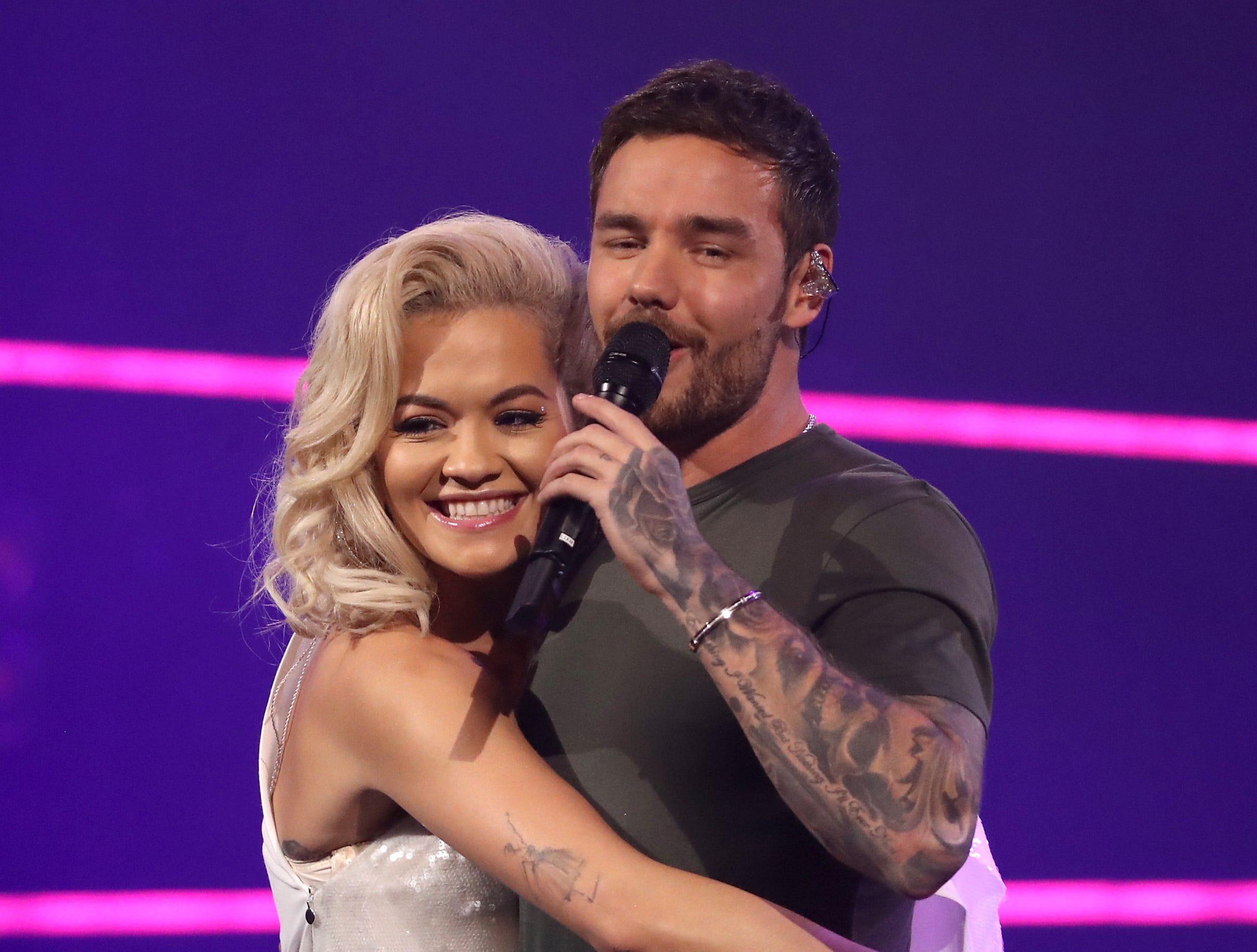 October 30: Rita Ora hugs  Liam Payne at Westfield White City in London, England.