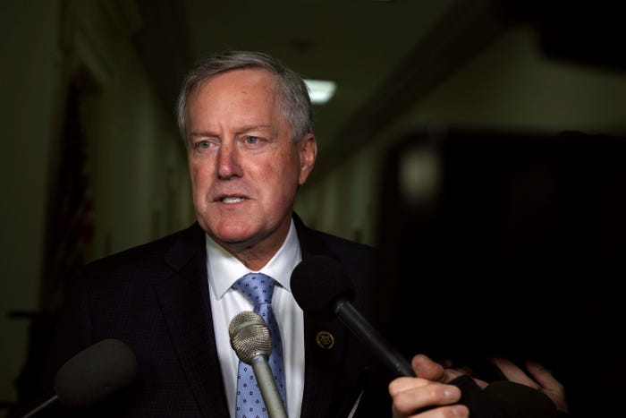 Trump, White House aide Mark Meadows downplay coronavirus risks even as governors rush to contain surging cases