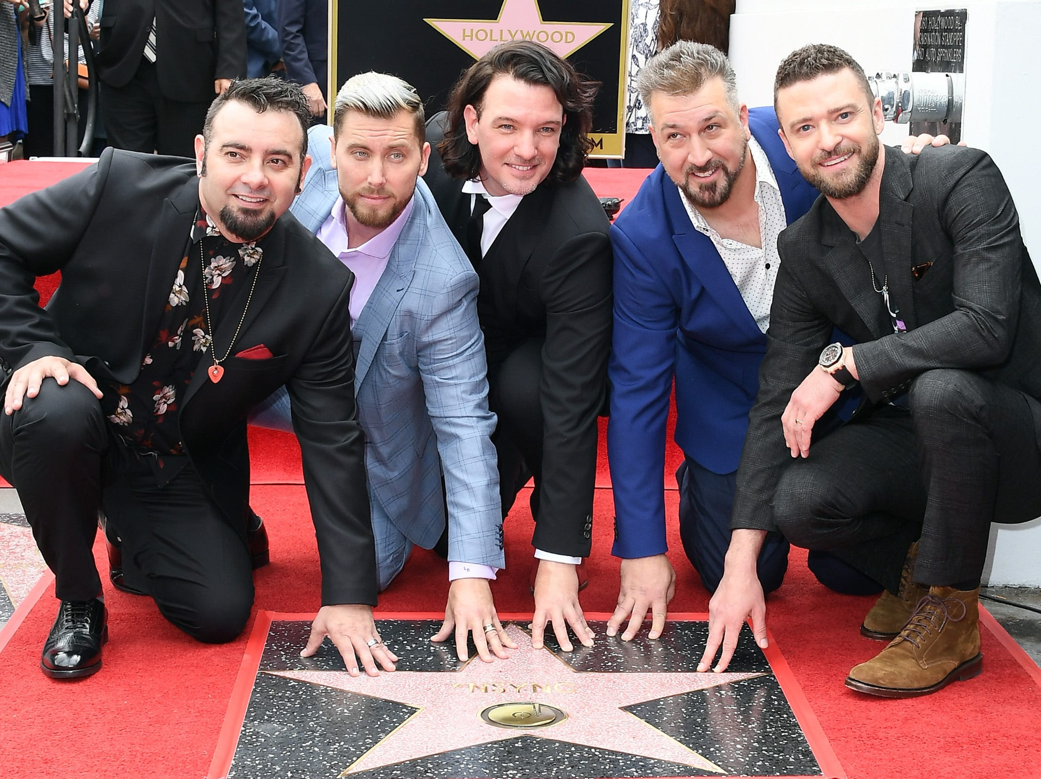 April 30:  NSYNC poses with their new star on the Hollywood Walk of Fame.