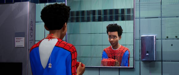 Miles Morales (Shameik Moore) is a Brooklyn kid with an African-American dad and Puerto Rican mom who learns how to be Spider-Man on the fly.