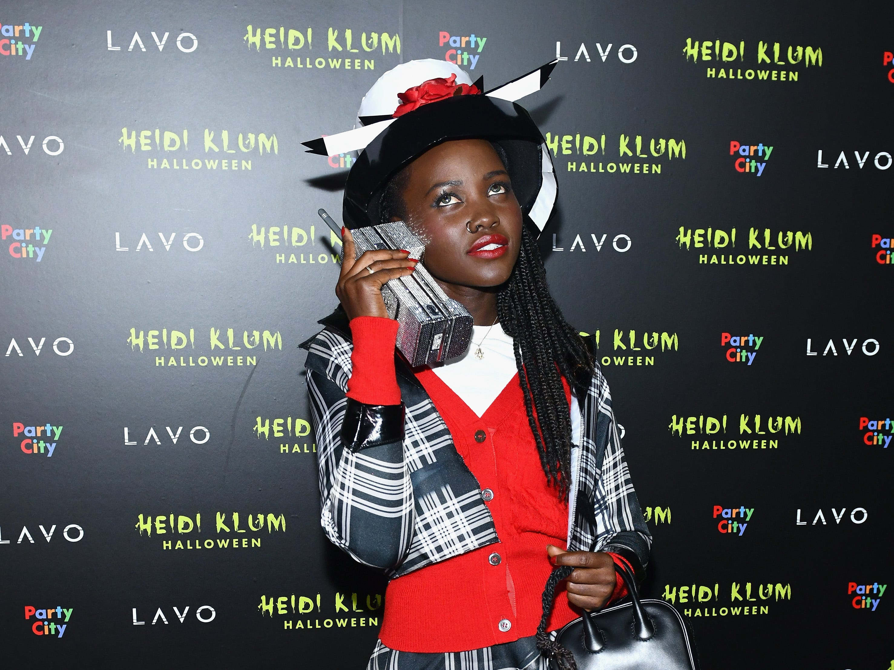 """October 31: Lupita Nyong'o channels """"Clueless"""" at Heidi Klum's 19th Annual Halloween Party in New York City."""