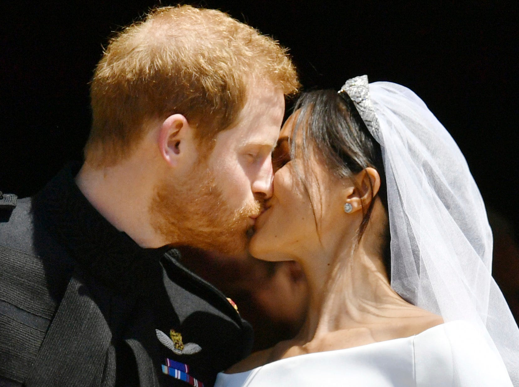 May 19: Prince Harry and Meghan Markle kiss on the steps of St. George's Chapel in Windsor Castle after their wedding ceremony.